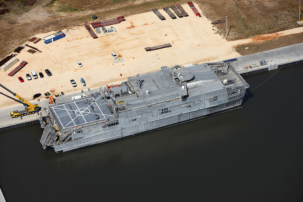 1024px-USNS_Choctaw_County_awaits_delivery._(9135925006).jpg
