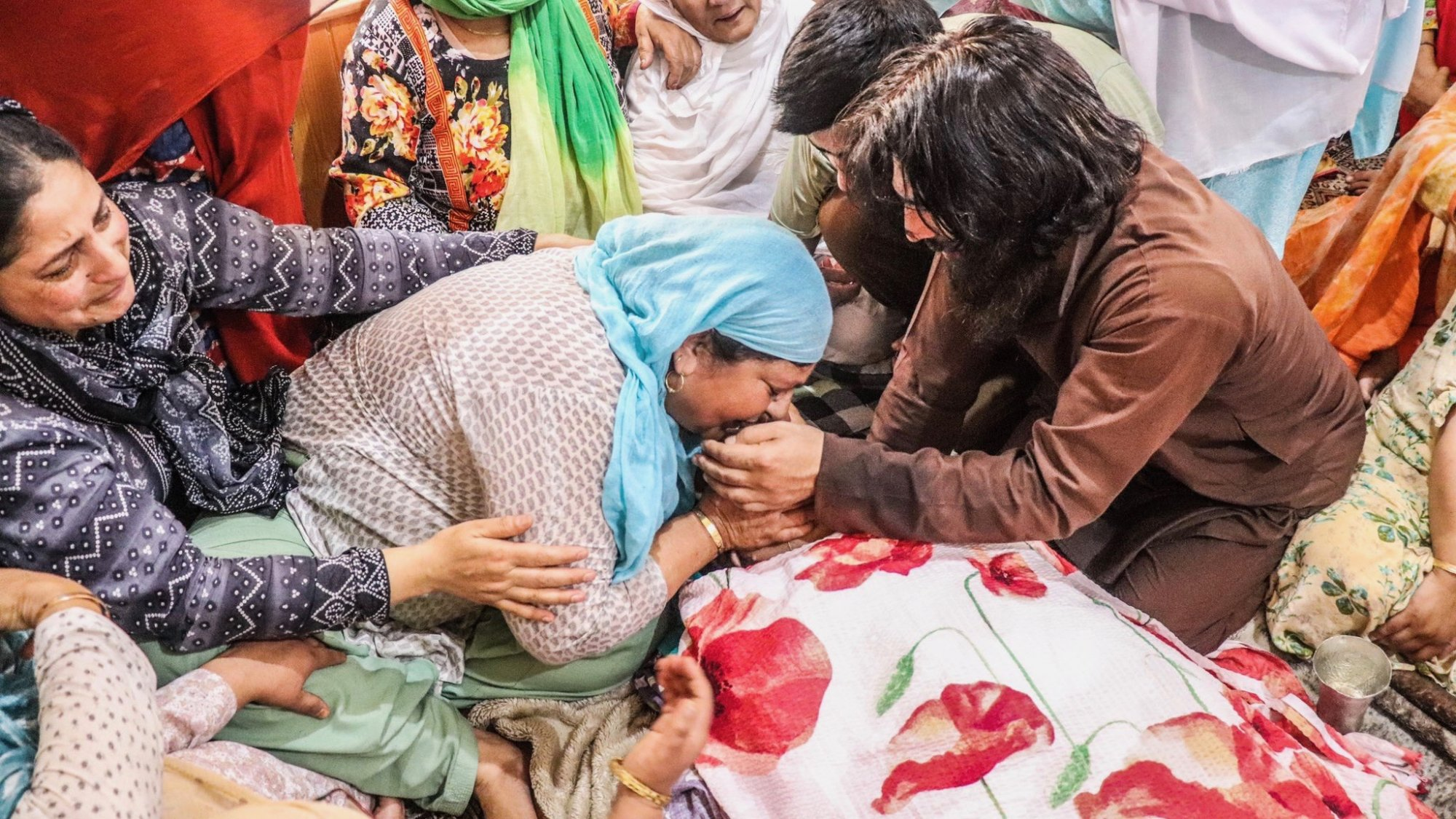 Family-members-mourns-the-killing-of-Bashir-Ahmad-Khan-after-he-body-was-brought-at-his-reside...jpg