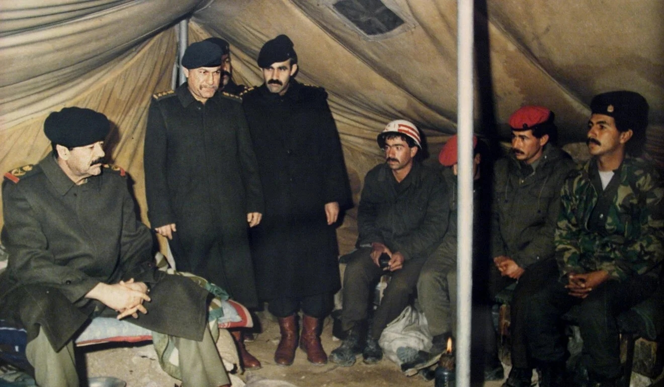 Many Iraqi troops, seen here being visited by Saddam Hussein (left) after their invasion of Ku...jpg