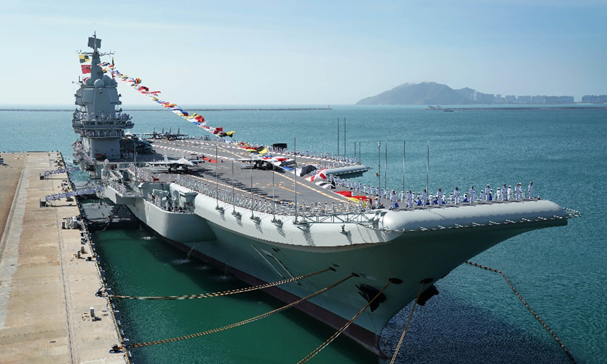 Shandong aircraft carrier is moored at a naval port in Sanya, south China's Hainan Province -...jpeg