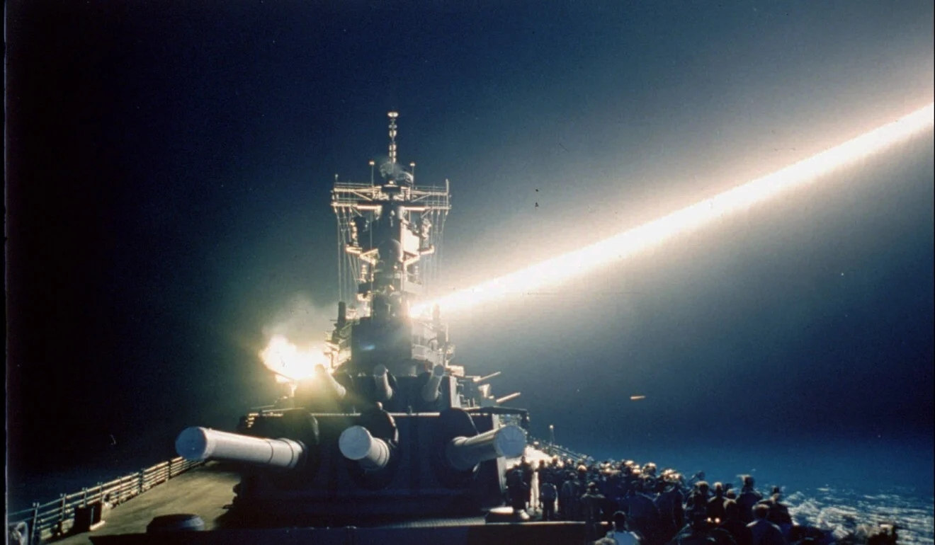Tomahawk cruise missile lights up the night sky as it is fired from the USS Wisconsin during t...jpg
