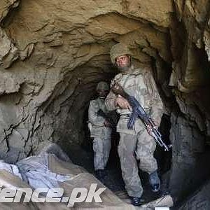 Soldiers showing captured tunnel on top of a mountain